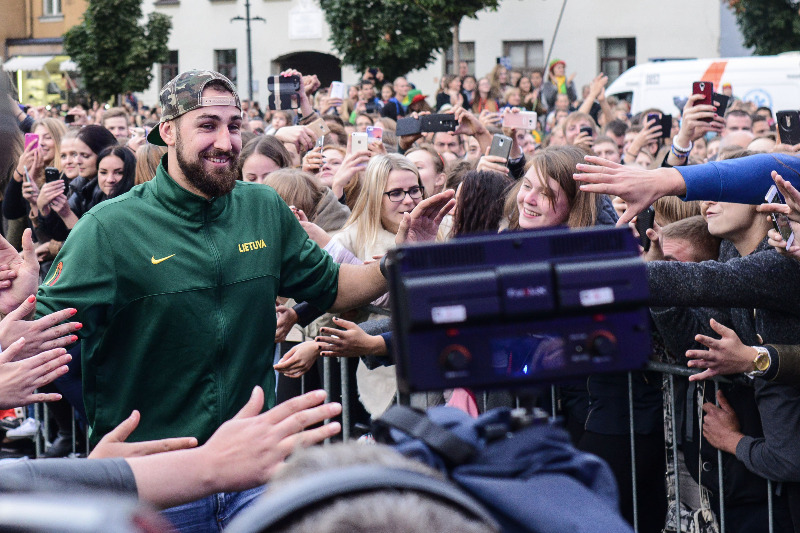 Jonas Valanciunas high-fives the fans who turned out to welcome their team home in Vilnius